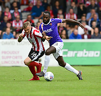 Lincoln City's Harry Anderson vies for possession with Exeter City's Hiram Boateng<br /> <br /> Photographer Chris Vaughan/CameraSport<br /> <br /> The EFL Sky Bet League Two Play Off First Leg - Lincoln City v Exeter City - Saturday 12th May 2018 - Sincil Bank - Lincoln<br /> <br /> World Copyright &copy; 2018 CameraSport. All rights reserved. 43 Linden Ave. Countesthorpe. Leicester. England. LE8 5PG - Tel: +44 (0) 116 277 4147 - admin@camerasport.com - www.camerasport.com