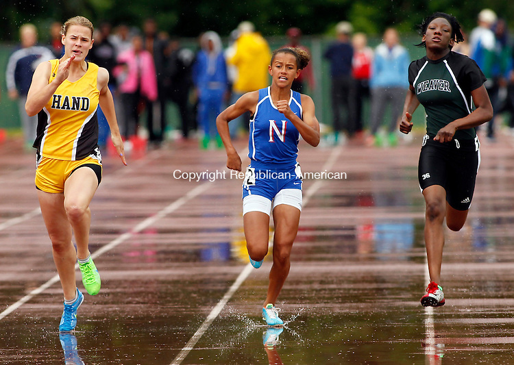 New Britain, CT-04 June 2012-060412CM08-  Nonnewaug's Michaela Pernell (center) sprints to the finish line during the 100m dash finals during the State Open Track and Field Championships Monday afternoon at Willow Brook Park in New Britain.  Pernell placed fifth with a time of 12.7.    Christopher Massa Republican-American