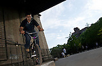 NEW YORK - MAY 30:  Skateboarders and bicyclists practice and ride at a New York City Skate Park under the Manhattan Bridge May 30, 2009 in New York City. (Photo by Donald Bowers)