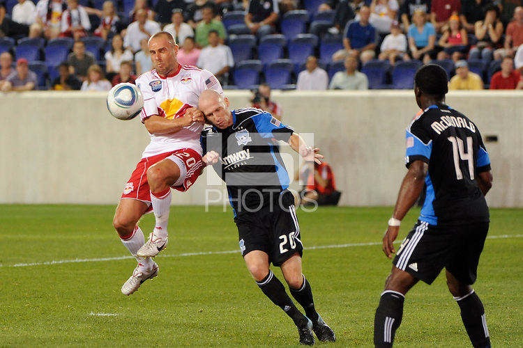 Joel Lindpere (20) of the New York Red Bulls and Tim Ward (20) of the San Jose Earthquakes battle for the ball. The New York Red Bulls defeated the San Jose Earthquakes 2-0 during a Major League Soccer (MLS) match at Red Bull Arena in Harrison, NJ, on August 28, 2010.