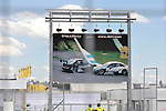 DTM-Auftakt 2009, 100. Rennen der Deutschen Tourenwagen Masters in Hockenheim - Leinwand zeigt den Unfall in den Ralf Schumacher (D), Trilux AMG Mercedes Mercedes-Benz, Trilux AMG Mercedes C-Klasse (2009) verwickelt war                                                                                            Foto © nph (  nordphoto  )