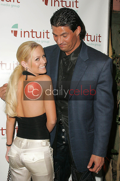Katie Lohmann and Jose Canseco<br /> at the Intuit Media Group Launch Party, The Little Door, Los Angeles, CA 02-23-06<br /> Dave Edwards/DailyCeleb.com 818-249-4998