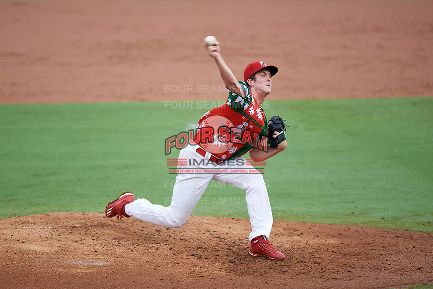 """Palm Beach Cardinals starting pitcher Jake Woodford (33) delivers a pitch during a game against the Charlotte Stone Crabs on July 22, 2017 at Roger Dean Stadium in Palm Beach, Florida.  The Cardinals wore special """"Ugly Sweater"""" jerseys for Christmas in July.  Charlotte defeated Palm Beach 5-2.  (Mike Janes/Four Seam Images)"""
