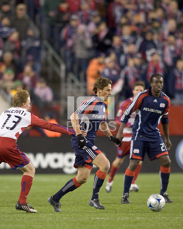 New England Revolution midfielder Wells Thompson (7) dribbles as FC Dallas midfielder Dax McCarty (13) defends. The New England Revolution defeated FC Dallas, 2-1, at Gillette Stadium on April 4, 2009. Photo by Andrew Katsampes /isiphotos.com