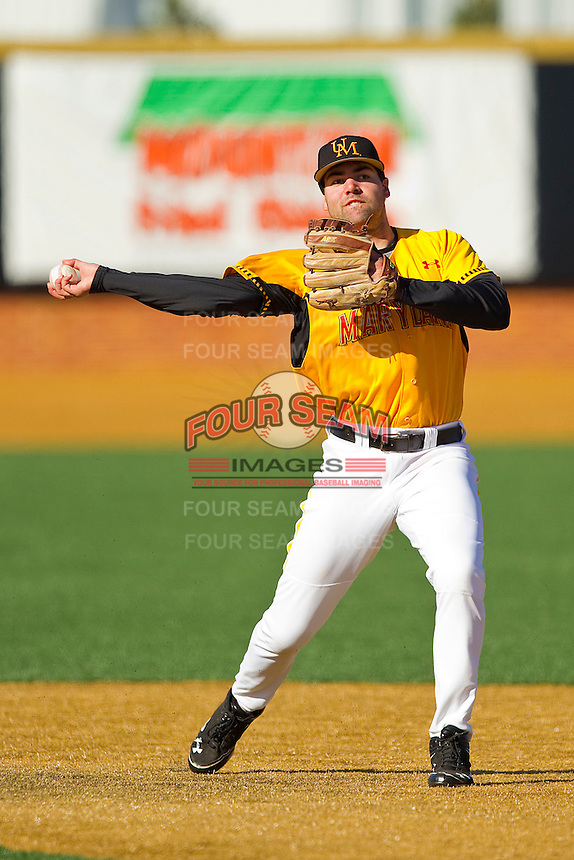Kyle Convissar #22 of the Maryland Terrapins makes a throw to first base during infield practice prior to the game against the Wake Forest Demon Deacons at Wake Forest Baseball Park on March 10, 2012 in Winston-Salem, North Carolina.  (Brian Westerholt/Sports On Film)