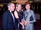 United States Senator Robert G. Torricelli (Democrat of New Jersey), left, and his companion, Democratic Fundraiser Patricia Duff, center, pose for a photo with Arianna Huffington at the White House Correspondent's Dinner at the Washington Hilton Hotel in Washington, D.C. on May 1, 1999..Credit: Ron Sachs / CNP