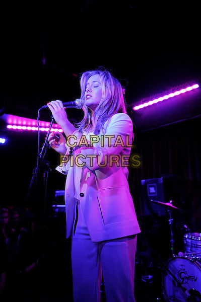 Caggie Dunlop performing in concert, Borderline, London, England. <br /> 9th October 2013<br /> on stage live gig performance music half length white blazer top singing side<br /> CAP/MAR<br /> &copy; Martin Harris/Capital Pictures