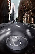Dollar sign on manholes symbolizing the economic status after Black Monday, when stock markets around the world crashed.