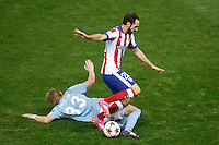 Atletico de Madrid´s Juanfran (R) and Malmo´s Forsberg during Champions League soccer match between Atletico de Madrid and Malmo at Vicente Calderon stadium in Madrid, Spain. October 22, 2014. (ALTERPHOTOS/Victor Blanco)