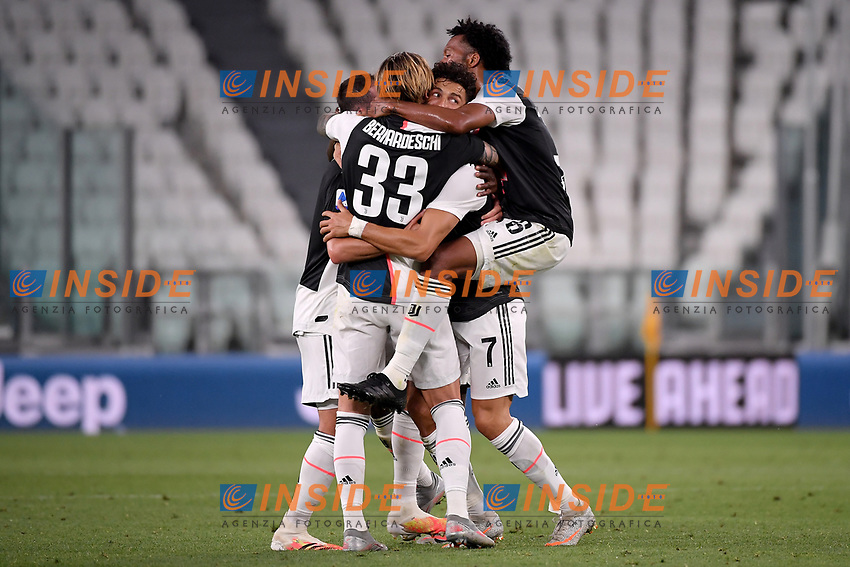 Cristiano Ronaldo of Juventus celebrates with Miralem Pjanic, Federico Bernardesch and Juan Cuadrado after scoring the goal of 1-0 during the Serie A football match between Juventus FC and UC Sampdoria at Juventus stadium in Turin (Italy), July 26th, 2020. Play resumes behind closed doors following the outbreak of the coronavirus disease. <br /> Photo Federico Tardito / Insidefoto