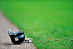 5 March 2011: A New York Yankees helmet lies next to the grass during a Spring Training game between the Washington Nationals and the New York Yankees at George M. Steinbrenner Field in Tampa, Florida. The Nationals defeated the Yankees 10-8 in Grapefruit League action. Mandatory Credit: Ed Wolfstein Photo