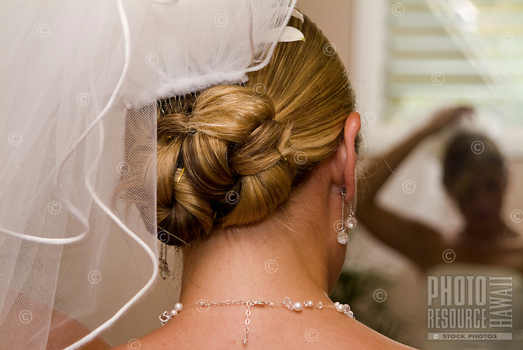 Close-up of a bride preparing for her wedding in Kailua (looking over her shoulder)