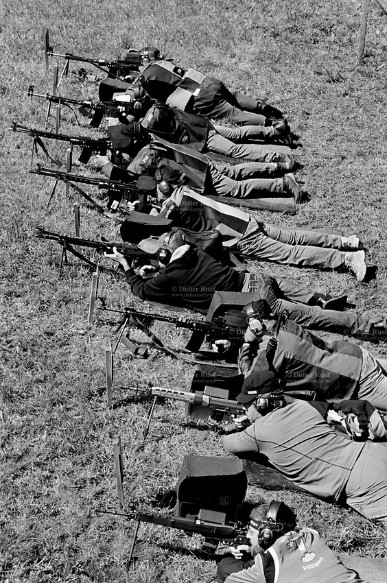 "Switzerland. Canton Bern. Guttannen. Every year, on August 14, the village of Guttannen organizes a shooting competition to commemorate the battlefield's memory from August 14, 1779  which took place on the Grimsel pass between the French and Austrian troops. More than 450 shooters (men and women) aim their rifles and automatic or semi-automatic assault rifles SG 550 on targets distant 380 meters. The SG 550 is an assault rifle manufactured by Swiss Arms AG (formerly Schweizerische Industrie Gesellschaft) of Neuhausen, Switzerland. ""SG"" is an abbreviation for Sturmgewehr, or ""assault rifle"". The rifle is based on the earlier 5.56mm SG 540 and is also known as the Fass 90 or Stgw 90. An assault rifle is a selective-fire rifle that uses an intermediate cartridge and a detachable magazine. 14.08.2017 © 2017 Didier Ruef"