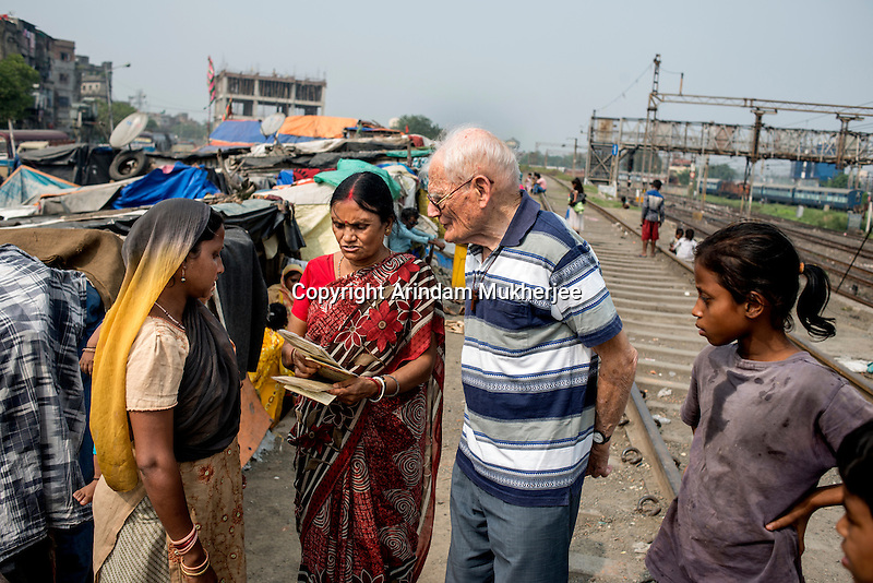 Father Laborde interacts with the slum dwellers during his visit to Tikiapara slum area in Howrah. West Bengal, India, Arindam Mukherjee/Agency Genesis