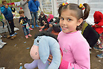 A girl holds a stuffed Eeyore inside a refugee processing center in the Serbian village of Presevo, not far from the Macedonian border. Hundreds of thousands of refugees and migrants--including many children--have flowed through Serbia in 2015, on their way from Syria, Iraq and other countries to western Europe.