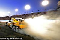 Nov. 9, 2008; Avondale, AZ, USA; NASCAR Sprint Cup Series driver Matt Kenseth burns out after pitting during the Checker Auto Parts 500 at Phoenix International Raceway. Mandatory Credit: Mark J. Rebilas-US PRESSWIRE
