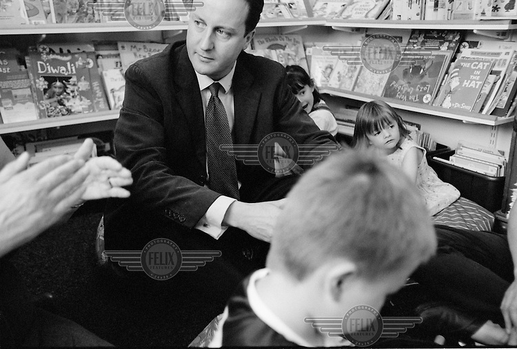 Politician David Cameron MP,  Leader of the British Conservative Party visits a local primary school in his constituency..