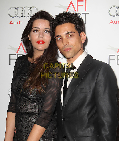 Anabela Moreira & guest.AFI FEST 2012 'On The Road' gala screening, Grauman's Chinese Theatre, Hollywood, California, USA..3rd November 2012.half length dress black lace suit red lipstick .CAP/ADM/KB.©Kevan Brooks/AdMedia/Capital Pictures.