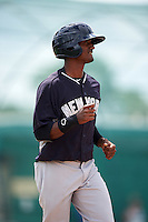 GCL Yankees 2 pinch runner Greidy Encarnacion (94) jogs to first during the first game of a doubleheader against the GCL Pirates on July 31, 2015 at the Pirate City in Bradenton, Florida.  GCL Pirates defeated the GCL Yankees 2 2-1.  (Mike Janes/Four Seam Images)