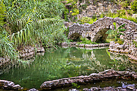 The Japanese Tea Garden located in Brackenridge Park in San Antonio Texas. The Japanese Tea Garden features a lush year-round garden and a floral display with shaded walkways, stone bridges, a 60-foot waterfall and ponds filled with Koi.