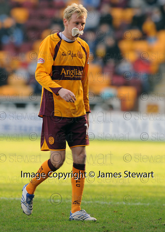 09/02/2008    Copyright Pic: James Stewart.File Name : sct_jspa18_motherwell_v_kilmarnock.STEPHEN HUGHES GOES OFF FOR TREATMENT TO A CUT MOUTH.James Stewart Photo Agency 19 Carronlea Drive, Falkirk. FK2 8DN      Vat Reg No. 607 6932 25.Studio      : +44 (0)1324 611191 .Mobile      : +44 (0)7721 416997.E-mail  :  jim@jspa.co.uk.If you require further information then contact Jim Stewart on any of the numbers above........