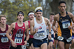 EVANSVILLE, IN - NOVEMBER 18: Greg Beaudette (143) Senior at Indiana (Pa.), Alexander Balla (241) Senior  at Shippensburg and Siem Mehretu (30) Junior at American Int'l push thru the first half of the Division II Men's Cross Country Championship held at the Angel Mounds on November 18, 2017 in Evansville, Indiana. (Photo by Tim Broekema/NCAA Photos/NCAA Photos via Getty Images)