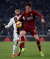 Nicolo Zaniolo of AS Roma and Rodrigo Bentancur of Juventus compete for the ball during the Serie A 2018/2019 football match between Juventus and AS Roma at Allianz Stadium, Roma, December 22, 2018 <br />
