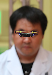 "June 9, 2016, Tokyo, Japan - An employee of Japanese toy maker CCP displays a tiny sized radio controlled toy drone ""AH Drone"", 6.5cm in length at the annual Tokyo Toy Show in Tokyo on Thursday, June 9, 2016. Some 160,000 people are expecting to visit the four-day toy trade show.   (Photo by Yoshio Tsunoda/AFLO) LWX -ytd-"