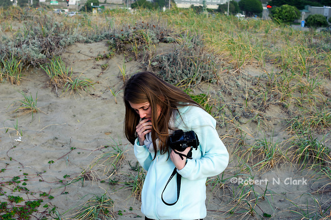 Pacific, California, public beach areaElizabeth enjoying herself with her camera on a drab day at the beach in Pacifica