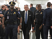 United States Senator Chuck Grassley (Republican of Iowa), walks in the hallway surrounded by US Capitol Police during a break in the testimony of Dr. Christine Blasey Ford  before the US Senate Committee on the Judiciary on the nomination of Judge Brett Kavanaugh to be Associate Justice of the US Supreme Court to replace the retiring Justice Anthony Kennedy on Capitol Hill in Washington, DC on Thursday, September 27, 2018.   <br /> Credit: Ron Sachs / CNP<br /> (RESTRICTION: NO New York or New Jersey Newspapers or newspapers within a 75 mile radius of New York City)