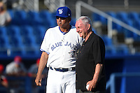 Florida State League President Ken Carson poses for a photo with Omar Malave (29) after throwing out the ceremonial first pitch before a game between the Clearwater Threshers and Dunedin Blue Jays on April 10, 2015 at Florida Auto Exchange Stadium in Dunedin, Florida.  Clearwater defeated Dunedin 2-0.  (Mike Janes/Four Seam Images)
