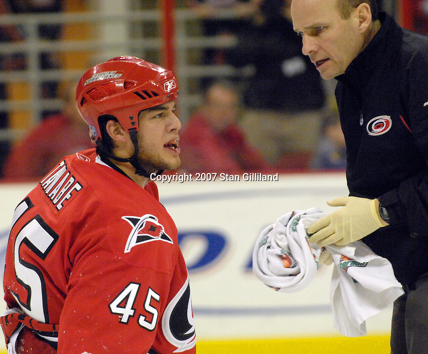 Carolina Hurricanes' David Tanabe yells at the officials after being hit in the face during a game against the Florida Panthers Tuesday, March 13, 2007 at the RBC Center in Raleigh, NC. Carolina won 3-1.