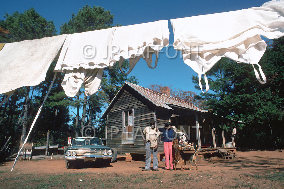 December 1976. Plains, Georgia. A couple in front of their home in Plains, they are some of the nearest neighbors of Jimmy Carter's family home.