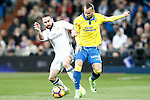 Real Madrid's Daniel Carvajal (l) and UD Las Palmas' Jese Rodriguez during La Liga match. March 1,2017. (ALTERPHOTOS/Acero)