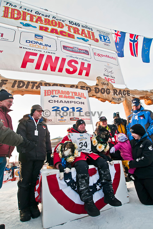 Dallas Seavey arrives in Nome to win his first Iditarod. At age 25, he is the youngest person ever to win an Iditarod. Iditarod 2012, Alaska. His father Mitch won the race in 2004, and his grandfather Dan is also running this race (3 generations of Seaveys on this race)