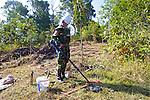 Cambodian Deminer Using Metal Detector