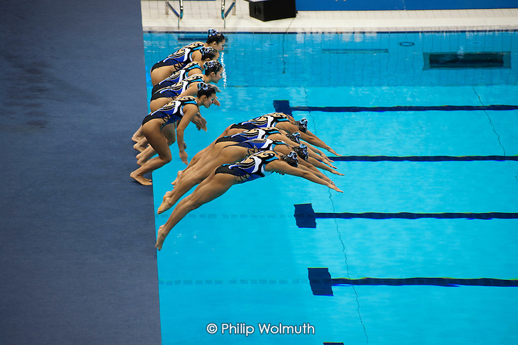 Japanese team, Olympic Games Synchronised Swimming Qualification event in the Aquatics Centre, designed by architect Zaha Hadid, Olympic Park, London.