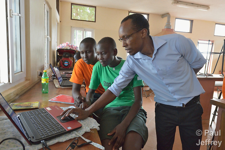 Students get help from a teacher in a computer class at the Loreto Girls Secondary School in Rumbek, South Sudan. The school is run by the Institute for the Blessed Virgin Mary--the Loreto Sisters--of Ireland.
