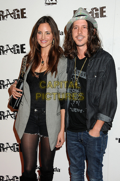 "Guest & Cisco Adler.""Rage"" Video Game Launch Party held in Chinatown's Historical Central Plaza, Los Angeles, California, .30th September 2011..half length  plaid hat grey gray denim shirt .CAP/ADM/BP.©Byron Purvis/AdMedia/Capital Pictures."
