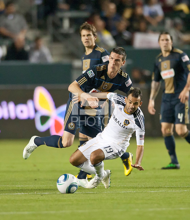 CARSON, CA – April 2, 2011: Philadelphia Union midfielder Sebastien Le Toux (25) and Juninho (19) battle for the ball during the match between LA Galaxy and Philadelphia Union at the Home Depot Center, March 26, 2011 in Carson, California. Final score LA Galaxy 1, Philadelphia Union 0.