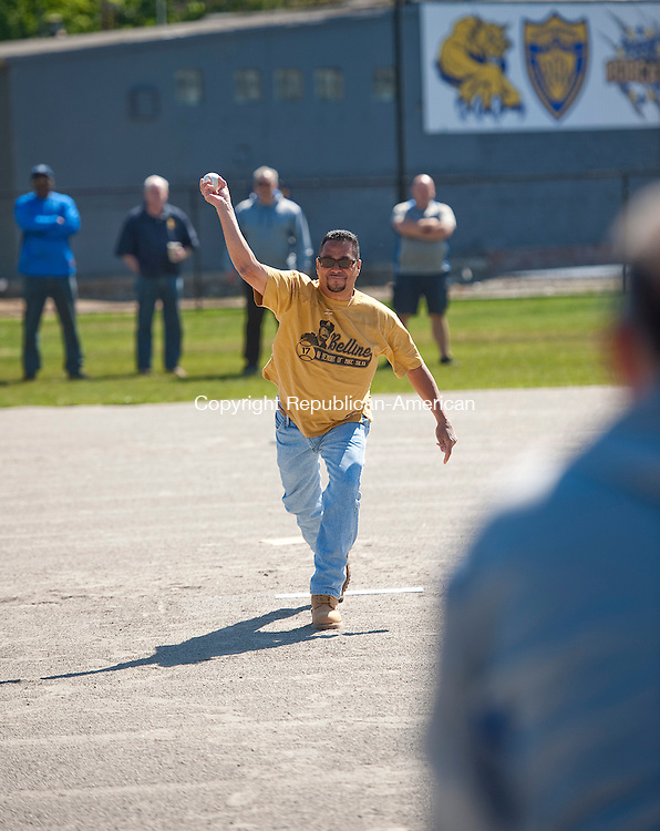 WATERBURY, CT--052315JS03-Geraldo Reyes, Aide to Waterbury Mayor Neil M. O'Leary, throws of the first pitch during the opening day  of the baseball field at PAL Park in Waterbury on Saturday. The PAL Bobcats light blue team and the green team played in the T-ball division. <br /> Jim Shannon Republican-American