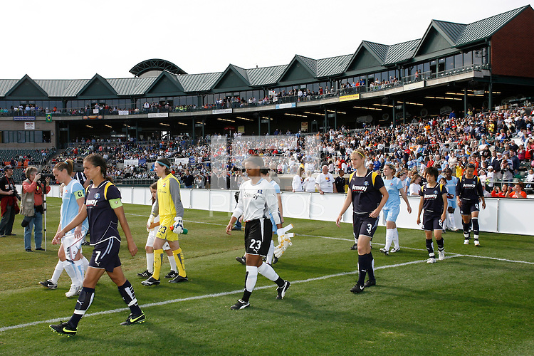 Christie Rampone (3) of Sky Blue FC and Shannon Boxx (7) of the Los Angeles Sol lead their teams onto the field before the start of the game. The Los Angeles Sol defeated Sky Blue FC 2-0 during a Women's Professional Soccer match at TD Bank Ballpark in Bridgewater, NJ, on April 5, 2009. Photo by Howard C. Smith/isiphotos.com