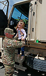 """Torrington, CT 051819MK09 U.S. Amry Specialist Mike LeBlanc helps Harlee Blum, from Terryville, from heavy equipment at the O&G Industries' annual Touch a Truck Family Fun Event at their maintenance facility on Saturday Morning.  Seth Duke, marketing director, said """" With the weather so nice today we will receive over two-thousand attendees and the suggested donations will be donated to Kids Play to help with their continued development.""""  O&G's Jim Zambero, vice president of equipment purchase and maintenance, said that sixty volunteers and twentyfive local vendors helped host the event while members of the Operational Engineer's Union Local #478 directed traffic and managed parking . Michael Kabelka / Republican-American"""