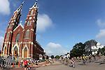 RAGBRAI riders roll past St. Francis Xavier Basilica in Dyersville on Saturday along RAGBRAI XXXVIII.