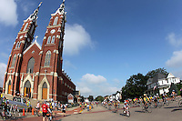 RAGBRAI riders roll past St. Francis Xavier Basilica in Dyersville on Saturday along RAGBRAI XXXVIII.