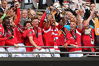 Salford City captain, Liam Hogan, holds the Trophy aloft as Salford City celebrate winning promotion to the Football League during AFC Fylde vs Salford City, Vanarama National League Football Promotion Final at Wembley Stadium on 11th May 2019