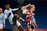 Elisha N'Dow of Aston Villa follows through on Olivia Fergusson of Sheffield United during the The FA Women's Championship match at the Proact Stadium, Chesterfield. Picture date: 12th January 2020. Picture credit should read: James Wilson/Sportimage