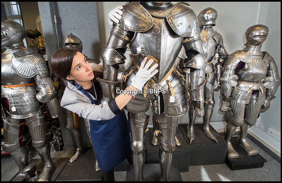 BNPS.co.uk (01202 558833)<br /> Pic: PhilYeomans/BNPS<br /> <br /> Sold for £40,000 - A 16th century Italian etched field armour gets it final polish in Thomas Del Mar's London saleroom.<br /> <br /> The £2.5 million pound sale of the John Woodman Higgins collection of arms and armour has concluded this week.<br /> <br /> At the height of the Renaissance a suit of armour cost many times the price of a Titian or Raphael 'It was the equilvalent cost of owning a Formula 1 team, your house and your wife's jewellry all rolled in to one' said Thomas Del Mar, 'Many Aristocrats bankrupted themselves in an arms race to have the most fashionable and functional suits.'