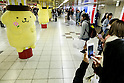 Shinjuku station commuters take pictures of a Sanrio's character Pom Pom Purin or Purin plush dolls displayed along in the Tokyo Metro Promenade on March 8, 2016, Tokyo, Japan. 11 of the huge cuddly characters will be displayed in an underground passage of Shinjuku Station until March 13, as a part of the celebrations for the 20th Birthday of Pom Pom Purin. Sanrio is a Japanese company established in 1963, which has created over 400 cute characters, including the worldwide known Hello Kitty. (Photo by Rodrigo Reyes Marin/AFLO)