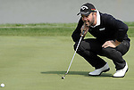 SUZHOU, CHINA - APRIL 16:  Christian Nilsson of Sweden lines up a putt on the 9th hole during the Round Two of the Volvo China Open on April 16, 2010 in Suzhou, China. Photo by Victor Fraile / The Power of Sport Images